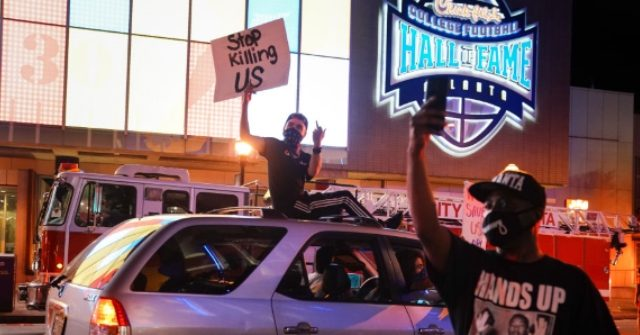 WATCH: Rioters Smash Windows, Loot College Football Hall of Fame